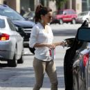 Eva Longoria stopped by the Ken Paves hair salon in Beverly Hills, California on March 24, 2012