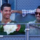 Cristiano Ronaldo of Real Madrid watches Rafael Nadal of Spain in action against Simone Bolelli of Italy in their third round match during day six of the Mutua Madrid Open tennis tournament at the Caja Magica on May 7, 2015 in Madrid, Spain