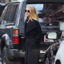 Dianna Agron in a long coat out in New York
