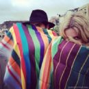 Friends Jared Leto and Annabelle Wallis wrapped in their blankets from India, 2012