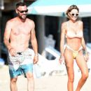 Tina Louise in a bikini with Brian Austin Green at the beach in Los Angeles - 454 x 566