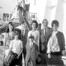 July 29th, 1963 - The Rt Hon Sir David Ormsby-Gore KCMG went aboard the Queen Mary on her arrival today at Southhampton with his children Julian (22, dark glasses), Jane (20) and Victoria (16) to meet his wife Lady Ormsby-Gore, daughter Alice (11, with co - 454 x 386
