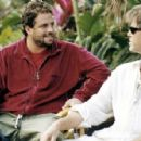Director Brett Ratner with Pierce Brosnan between takes on the set of New Line Cinema's film AFTER THE SUNSET. © 2004 Glen Wilson/New Line