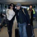 George Clooney and Amal Alamuddin make their way through Heathrow Airport on Thursday (November 27, 2014) in London, UK