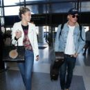 Cody Simpson seen Departing LAX with his Girlfriend December 28, 2014