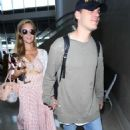 Paris Hilton and Chris Zylka at LAX Airport in Los Angeles - 454 x 681