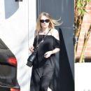Dakota Fanning in Black Dress at Nine Zero One salon in West Hollywood - 454 x 647