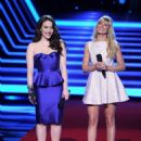 Kat Dennings (L) and Beth Behrs speak onstage at The 40th Annual People's Choice Awards at Nokia Theatre L.A. Live on January 8, 2014 in Los Angeles, California.