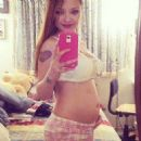 Tila Tequila announced she's pregnant and expecting her first child via Facebook on Friday, April 18, 2014 this is her first baby bump picture