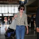 Milla Jovovich is seen at LAX - 400 x 600