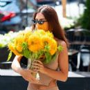 Emily Ratajkowski – Seen while is out with a vase of flowers in New York City
