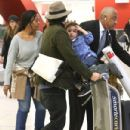 Orlando Bloom and his son Flynn arriving on a flight at LAX airport in Los Angeles, California on January 9, 2014