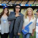 Musician Gene Simmons attends the Dodgers v Ny Mets game to throw out the first pitch of the game at Dodger Stadium pictured with (L-r) Emily Tweed, Sophie Simmons, Shannon Tweed and Jamey Carroll baseball player on July 5, 2011 in Los Angeles, California - 454 x 257