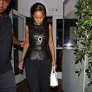 Rihanna shields her eyes from camera flashes as she leaves Il Ristorante di Giorgio Baldi - 380 x 594