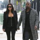 Kim Kardashian and Kanye West holding hands as they leave Milk Studios in West Hollywood, California on December 20, 2014