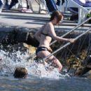 Lily Collins in Black Bikini at the beach in Ischia - 454 x 303