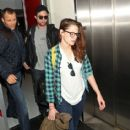 Robert Pattinson and Kristen Stewart seen arriving together to LAX Los Angeles Airport after flying from New York November 26,2012