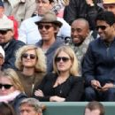 Leonardo DiCaprio and his friend Lukas Haas attend the French tennis Open round of 16 match at the Roland Garros stadium in Paris. Jo-Wilfried Tsonga of France plays against Viktor Troicki of Serbia, and Roger Federer of Switzerland over Gilles Simon of F - 454 x 301