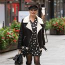 Kelly Brook – Seen at Heart radio wearing a polka dot mini dress and cap in London