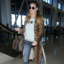 Heidi Klum is seen arriving on a flight at LAX airport in Los Angeles, California on January 23, 2017 - 411 x 600