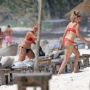 Ashley Tisdale in Red Bikini at a beach in Mexico - 454 x 376