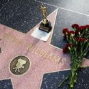 Flowers are placed in memory of actor/comedian Robin Williams' Walk of Fame star in the Hollywood district of Los Angeles on Monday August 11, 2014