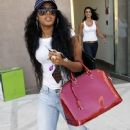 ANGELA SIMMONS Shows Off Her Red Patent Louis Vuitton Bag