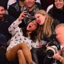 Cara Delevingne and Michelle Rodriguez at the New York Knicks game against the Detroit Pistons at Madison Square Garden in New York on Tuesday January 7, 2014