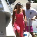 Kim Kardashian in Pink Tights on a boat in Miami