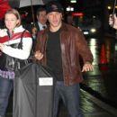Matt Damon holds onto a Calvin Klein suit as he arrives for an appearance on
