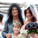 SLASH AND PERLA HUDSON RENEW THEIR VOWS IN IBIZA.In Spain on the magical island of Ibiza, Slash and Perla Hudson renewed their wedding vows yesterday (August 29) for their 10-year anniversary. The celebration included their beautiful two sons--London (9),