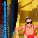 Billie Faiers in Red Swimsuit at a water park in Dubai - 454 x 693