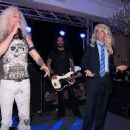 Donald Trump Jr and Dee Snider perform at The Eric Trump 8th Annual Golf Tournament at Trump National Golf Club Westchester on September 15, 2014 in Briarcliff Manor, New York. - 454 x 369