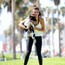 Nina Dobrev with Her Puppy Maverick at a Park in Los Angeles July 6, 2017 - 454 x 545