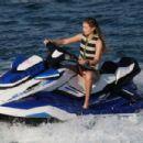 Gigi Hadid in Black Bikini on the beach in Mykonos