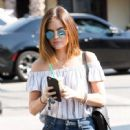 Actress and singer Lucy Hale stops by Starbucks in Los Angeles, California to pick up an iced coffee on August 24, 2016 - 449 x 600