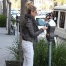Ashley Tisdale spending some cash at Planet Blue in Beverly Hills, California on December 10th, 2012