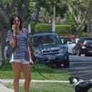 Nina Dobrev in Shorts – Walks her dog Maverick in Los Angeles