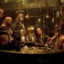 MacKenzie Crook as Ragetti, Kevin McNally as Gibbs, Lee Arenberg as Pintel, Johnny Depp as Jack Sparrow, Orlando Bloom as Will Turner and Naomie Harris as Tia Dalma in Walt Disney Pictures' Pirates of the Caribbean: Dead Man's Chest - 2006