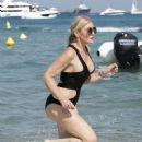 Hofit Golan in Black Swimsuit at the beach in Saint Tropez - 454 x 681