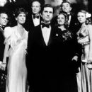 Some of the cast of The Last Tycoon. From left to right: Tony Curtis, Leslie Curtis, Ray Milland, Robert De Niro, Jeanne Moreau, Robert Mitchum, and Theresa Russell - 454 x 332