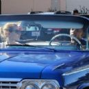 Nick Young and his rapper girlfriend Iggy Azelea ride in style to grab some Chick-fil-A in Los Angeles California on December 23, 2014 - 454 x 304