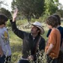 Director ROBERT RODRIGUEZ (center) explains a scene to LEO HOWARD, TREVOR GAGNON and REBEL RODRIGUEZ on the set of Warner Bros. Pictures' magical fantasy adventure 'Shorts.' Photo by Van Redin - 454 x 302