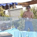 Jenny McCarthy - Relaxing Under An Umbrella In Malibu, 05.07.2008.