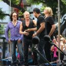 Joe Elliott, Phil Collen and Vivian Campbell of Def Leppard appear for a performance and interview with Mario Lopez of 'Extra' at The Grove, California on June 1st, 2012 - 454 x 475