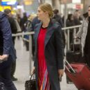 Rosamund Pike – Arrives at Heathrow Airport in London - 454 x 704