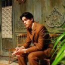 Javier Beltrán as Federico García Lorca sitting Magdalena's aunt's hallway. - 454 x 304