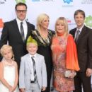 Tori Spelling and her family attending at various events through the years - 454 x 337