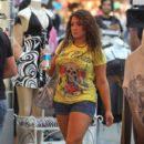 "Deena Cortese hit the boardwalk for some shopping retail therapy at ""Sand Tropez"" before their last night out for season three of ""Jersey Shore"