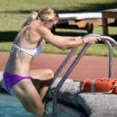 Caroline Wozniacki in Bikini at a pool in in Italy - 454 x 303